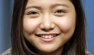 """Recording artist Charice Pempengco poses for a portrait in New York, Thursday, April 15, 2010.  Charice has had noninvasive cosmetic procedures in preparation for her debut in the second season of the hit TV show """"Glee.""""  (AP Photo/Jeff Christensen)"""