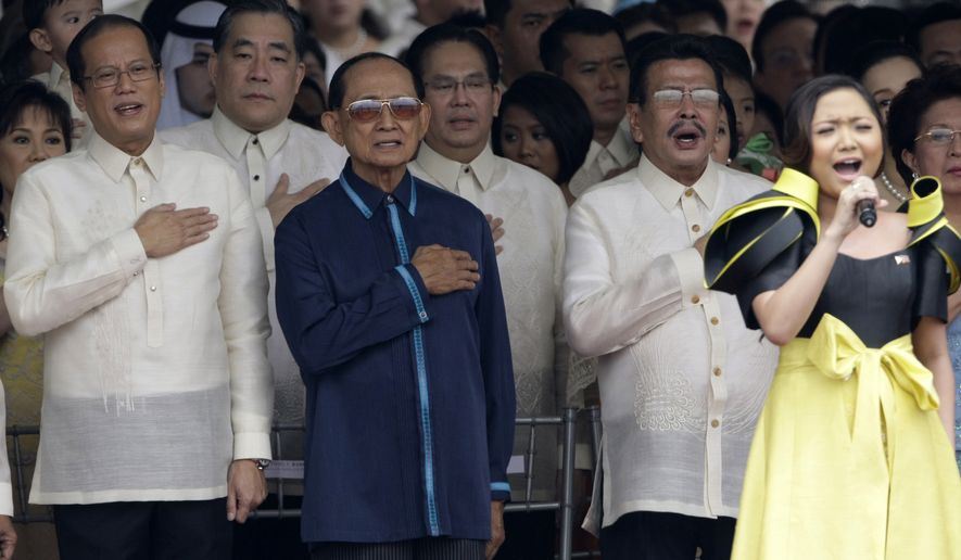 President Benigno Aquino III, left, former President Fidel Ramos, 2nd left, and former President Joseph Estrada, second right, join as Charice Pempengco sings the national anthem during the inauguration ceremony Wednesday, June 30, 2010 in Manila, Philippines. (AP Photo/Pat Roque)
