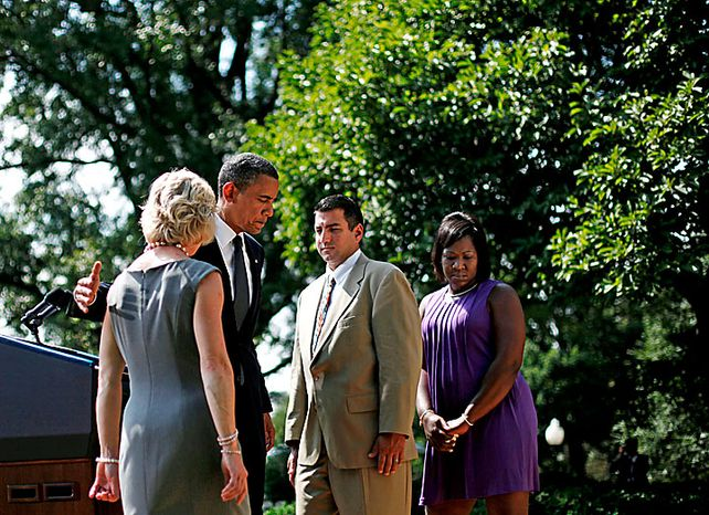 President Barack Obama, second from the left, walks away from the podium with from left to right, Leslie Macko, from Charlottesville Va., Jim Chukalas, from Fredon Township, NJ., and Denise Gibson, from Brooklyn, NY., after delivering remarks on the extending unemployment insurance in the Rose Garden of the White House in Washington, Monday, July 19, 2010. (AP Photo/Pablo Martinez Monsivais)