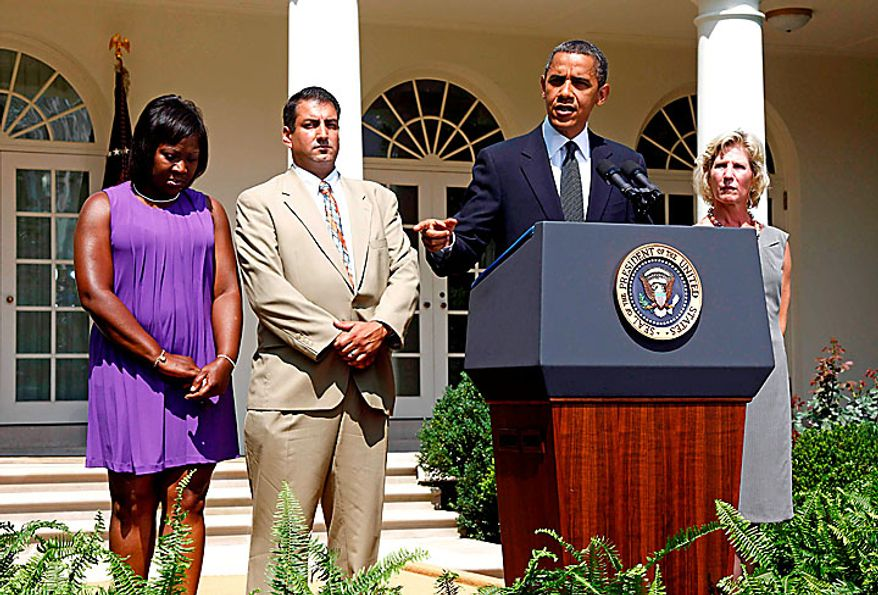 President Barack Obama stands with, from left to right: Denise Gibson from Brooklyn, N.Y., Jim Chukalas from Fredon Township, N.J., and Leslie Macko from Charlottesville, Va., all unemployed, as he speaks about the unemployment insurance and the economy in the Rose Garden of the White House in Washington, Monday, July 19, 2010. (AP Photo/Charles Dharapak)