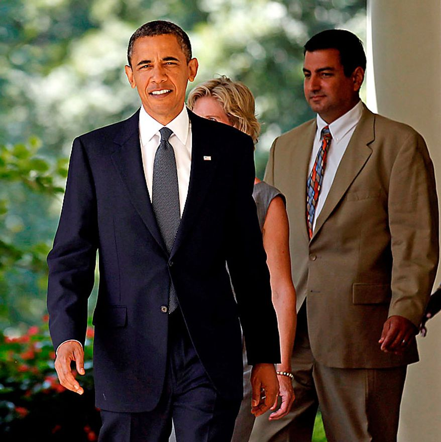 President Barack Obama, left, walks out of the Oval Office of the White House Leslie Macko, center, from Charlottesville Va., and Jim Chukalas, from Fredon Township, N.J., before delivering remarks on extending unemployment insurance, Monday, July 19, 2010. (AP Photo/Pablo Martinez Monsivais)