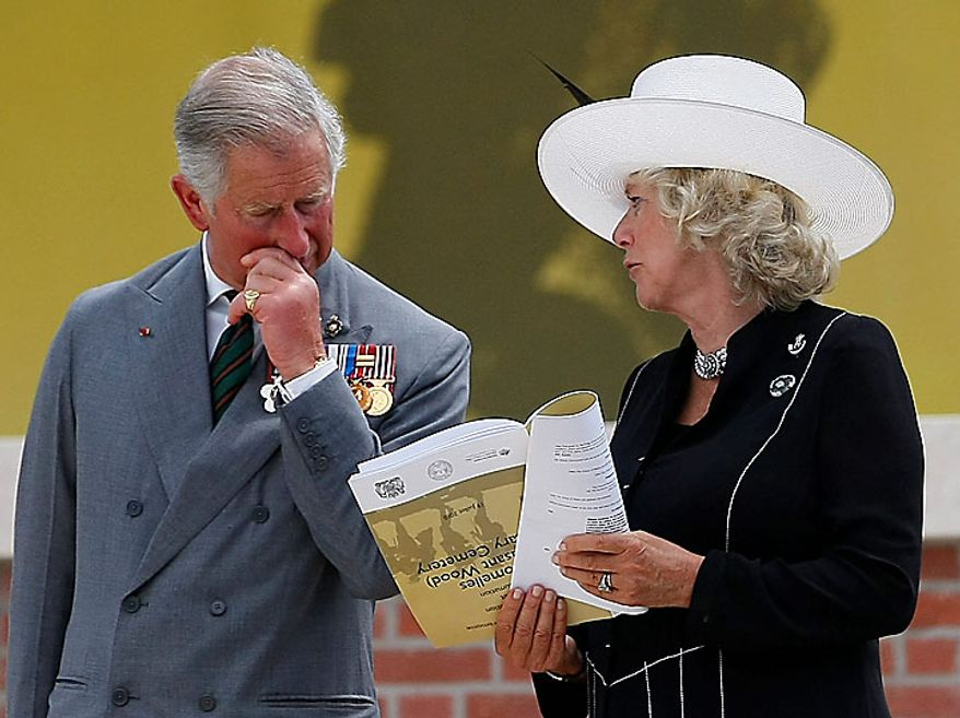 Prince Charles and his wife, Camilla, Duchess of Cornwall, talk during the service of rededication at the Fromelles (Pheasant Wood) Military Cemetery, northern France, Monday, July 19, 2010. Ceremonies are marking the 94th anniversary of the World War I Battle of the Somme. (AP Photo/Michel Spingler)