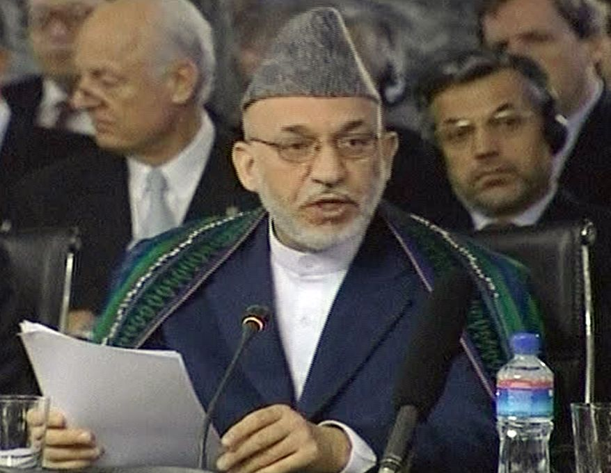 In this image made from TV footage, Afghan President Hamid Karzai delivers his speech at an international conference on Afghanistan's future in Kabul, Afghanistan, on Tuesday July 20, 2010. Mr. Karzai reaffirmed his commitment for Afghan police and soldiers to take charge of security throughout the nation by 2014 and urged his international partners to spend their money on Afghan priorities, not short-term projects. (AP Photo/RTV via APTN)