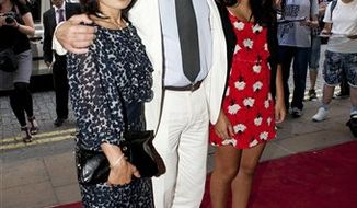 Oliver Stone attends the premiere of South of the Border, at the Curzon cinema in Mayfair, central London, with his wife Chong Son Chong (left) and daughter Tara Chong (right) Monday July 19, 2010. (AP Photo / PA) ** UNITED KINGDOM OUT - NO SALES - NO ARCHIVES