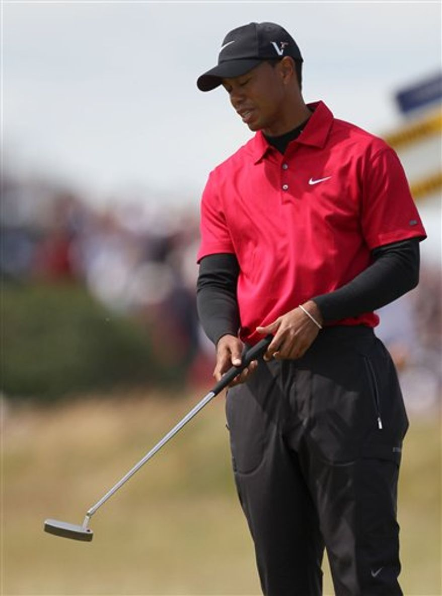 Tiger Woods of the United States reacts on the 9th green during his final round of the British Open Golf Championship on the Old Course at St. Andrews, Scotland, Sunday, July 18, 2010. (AP Photo/Alastair Grant)