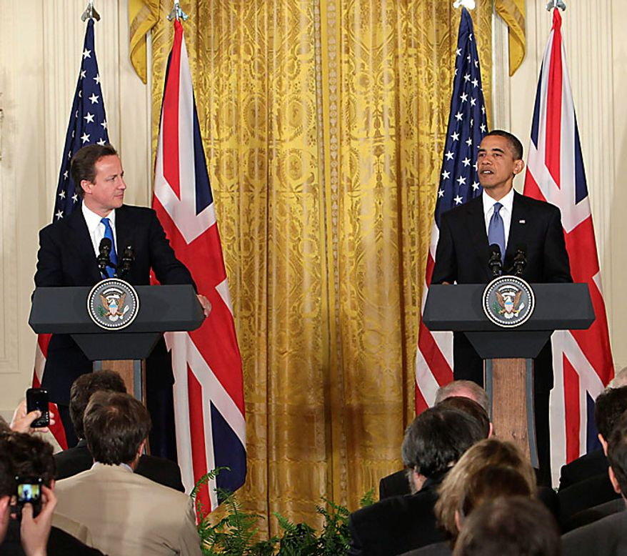 President Barack Obama and British Prime Minister David Cameron hold a joint news conference in the East Room of the White House in Washington, Tuesday, July 20, 2010. (AP Photo/Carolyn Kaster)