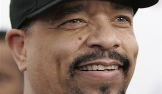 """FILE - In this March 22, 2010 file photo, rapper-actor Ice-T arrives for the special screening of Tyler Perry's """"Why Did I Get Married Too?"""" in New York.  (AP Photo/Jessica Rinaldi, file)"""