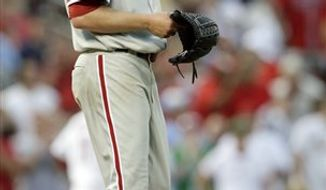 Philadelphia Phillies starting pitcher Kyle Kendrick (38) reacts to giving up a home run, his third of the inning, to St. Louis Cardinals' Skip Schumaker in the fifth  inning of a baseball game, Monday, July 19, 2010 in St. Louis.(AP Photo/Tom Gannam)