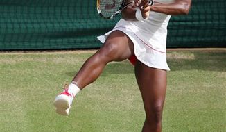 FILE _ In this July 1, 2010, file photo, Serena Williams, of the United States, makes a backhand return shot to Petra Kvitova, of the Czech Republic, at the All England Lawn Tennis Championships at Wimbledon, England. The WTA Tour says Williams is questionable for the U.S. Open because of her recent foot injury. Williams cut her right foot on broken glass at a restaurant shortly after winning Wimbledon. The tour said last week she needed surgery and would miss three tournaments leading up to the Open. (AP Photo/Alastair Grant, File)