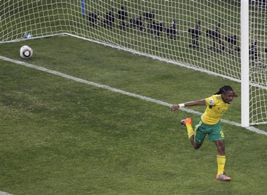 "FILE - In this Friday June 11 2010 file photo,  South Africa's Siphiwe Tshabalala celebrates after scoring the opening goal of the World Cup Soccer Tournament at the Soccer City Stadium in Johannesburg. South Africa's soccer association says the shoes Siphiwe Tshabalala used to score the first goal at the World Cup will become a ""historic monument"" to South African soccer. SAFA chief executive Leslie Sedibe told a parliamentary committee on Tuesday, July 20, 2010, that the shoes will go on display at SAFA headquarters in Johannesburg. (AP Photo/Marcio Sanchez, File)"