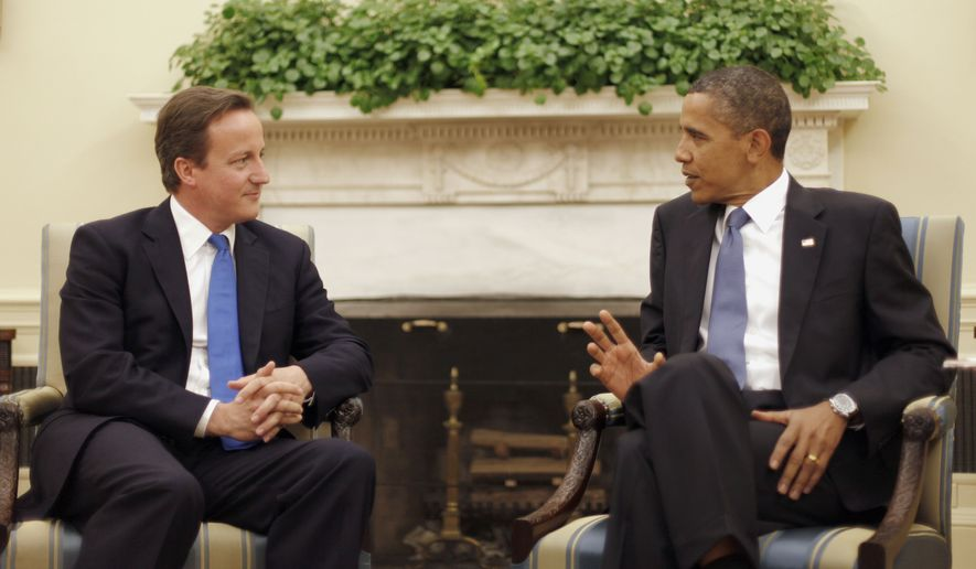 President Obama, right, and British Prime Minister David Cameron, left, talk in the Oval Office of the White House in Washington, Tuesday, July 20, 2010. (AP Photo/Pablo Martinez Monsivais)