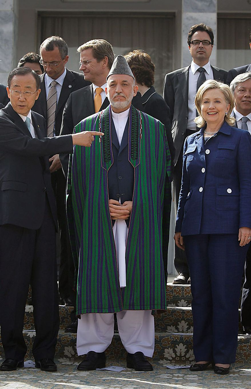U.N. Secretary General Ban Ki-moon, left, gestures as Afghan President Hamid Karzai, center, and U.S. Secretary of State Hillary Rodham Clinton, right, prepare to pose for a group photo after the Kabul International Conference at the Foreign Ministry in Kabul, Afghanistan on Tuesday, July 20, 2010. (AP Photo/Musadeq Sadeq)