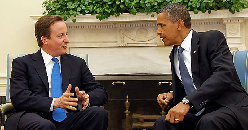 President Barack Obama, right, and British Prime Minister David Cameron, left, talk during their meeting in the Oval Office of the White House in Washington on Tuesday, July 20, 2010. (AP Photo/Pablo Martinez Monsivais)