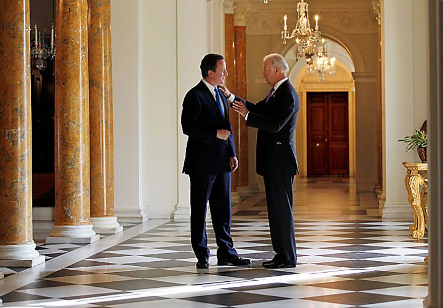 British Prime Minister David Cameron, left, hosts a breakfast meeting with Vice President Joe Biden at the British Embassy in Washington, Tuesday, July 20, 2010. (AP Photo/J. Scott Applewhite)