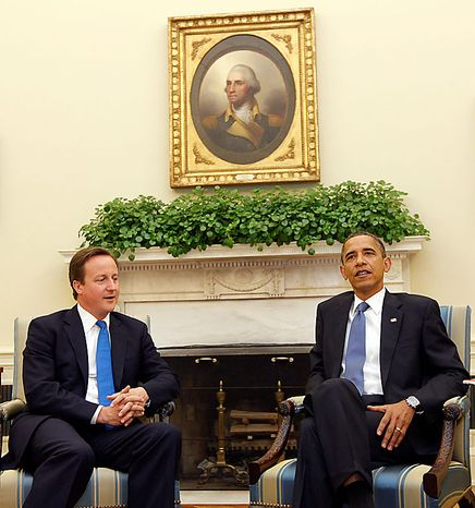 President Barack Obama, right, and British Prime Minister David Cameron, left, talk during their meeting in the Oval Office of the White House in Was