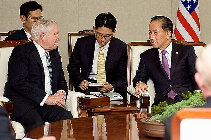 In a photo provided by the Defense Department, Defense Secretary Robert M. Gates, left, meets with Korean Minister of National Defense Kim Tae Young, right, in Seoul South Korea, Tuesday, July 20, 2010.  (AP Photo/Cherie Cullen)