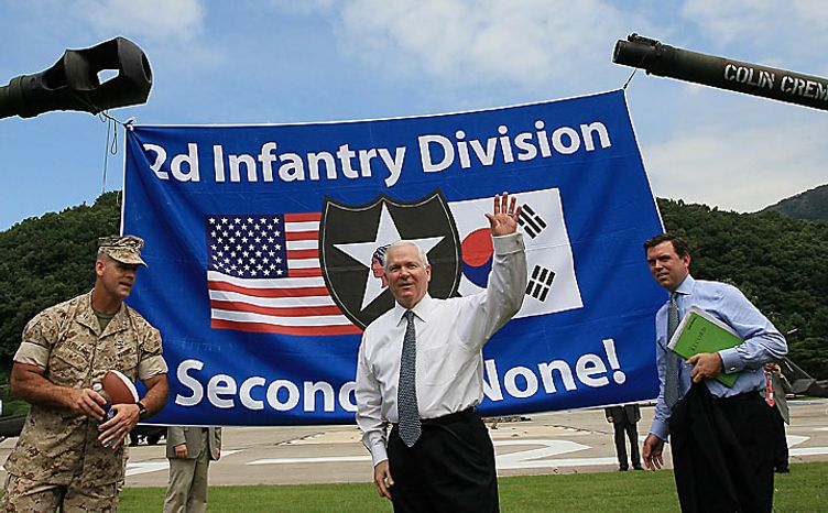 U.S. Secretary of Defense Robert Gates waves as he departs after meeting with soldiers during a stop at Camp Casey on July 20, 2010 in Seoul, South Korea. Mr. Gates greeted troops from the 1st Heavy Brigade and the 210 Fires Brigade and presented each one with a Secretary of Defense challange coin. (AP Photo/Mark Wilson, pool)