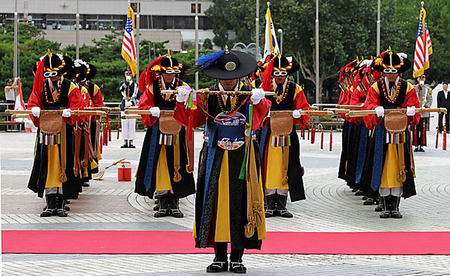 South Korean honor guard soldiers wearing traditional military uniforms, salute during a rehearsal for the welcoming ceremony of U.S. Secretary of State Hillary Rodham Clinton and Defense Secretary Robert Gates in Seoul, South Korea, Tuesday, July 20, 2010. Mr. Gates, who arrived on Monday, will be joined by Clinton on Wednesday for high-profile security talks with their South Korean colleagues, a meeting meant to underscore Washington's firm alliance with Seoul as the two nations plan military exercises in a message of deterrence to North Korea. (AP Photo/Lee Jin-man)