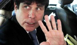ASSOCIATED PRESS Former Ilinois Gov. Rod R. Blagojevich acknowledges reporters and onlookers as he leaves the federal court building in Chicago after telling the judge in his corruption trial he will not testify.