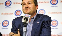 Chicago Cubs owner Tom Ricketts ponders a question about manager Lou Piniella, who announced that he will retire from coaching at the end of this season, during a baseball news conference at Wrigley Field on Tuesday, July 20, 2010, in Chicago. (AP Photo/Jim Prisching)