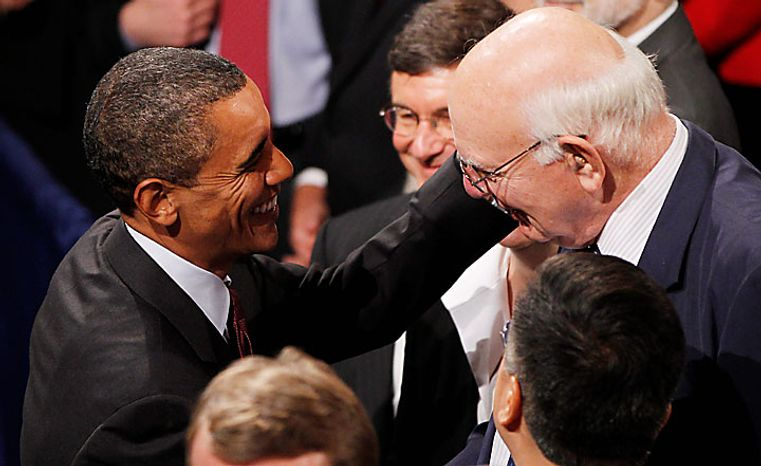 President Barack Obama greets Paul Volcker, Chair of the President's Economic Recovery Advisory Board, after Obama signed the Dodd-Frank Wall Street Reform and Consumer Protection financial reform bill at the Ronald Reagan Building in Washington, Wednesday, July 21, 2010. (AP Photo/Charles Dharapak)
