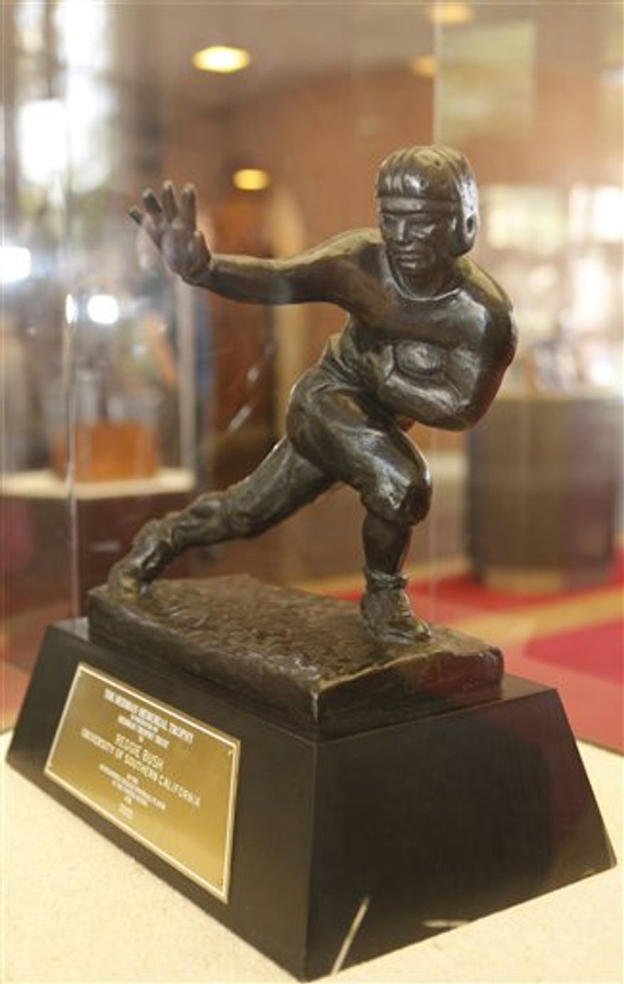 University of Southern California's Reggie Bush Heisman Trophy is displayed at the Heritage Hall on the USC campus in Los Angeles on Tuesday, July 20, 2010. USC will return Bush's trophy to the Heisman Trophy Trust next month, possibly indicating the trophy will be revoked in the future. The school will take down any jerseys or murals recognizing the former star tailback or basketball player O.J. Mayo, the other major figure in the four-year NCAA investigation. (AP Photo/Damian Dovarganes)