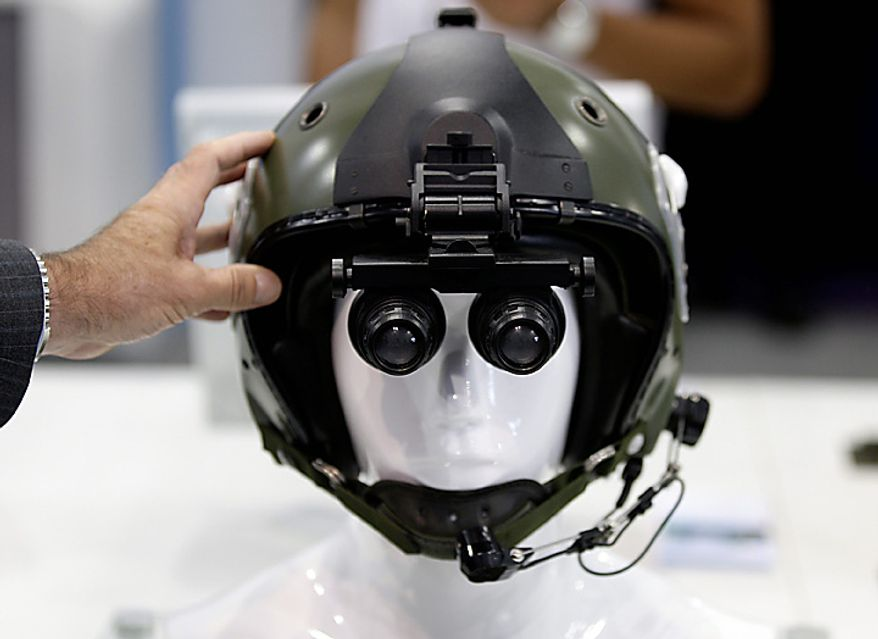Thales SA Helie night vision goggles are seen on display on the third day of the Farnborough International Airshow in Farnborough, England, on Wednesday, July 21, 2010. The Farnborough International Airshow is being held from July 19-25. Photographer: Simon Dawson/Bloomberg