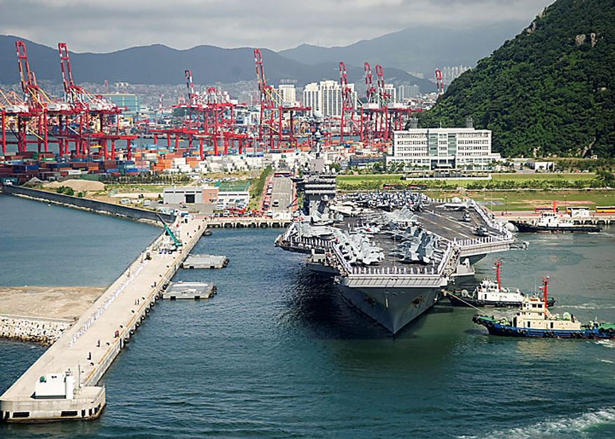 In a Wednesday, July 21, 2010, photo provided by the Navy Visual News Service, the aircraft carrier USS George Washington (CVN 73) arrives in Busan, Republic of Korea, to take part in four days of joint military exercises between the Republic of Korea and the United States that starts Sunday. (AP Photo/Navy Visual News Service, PO 3rd class Charles Oki)