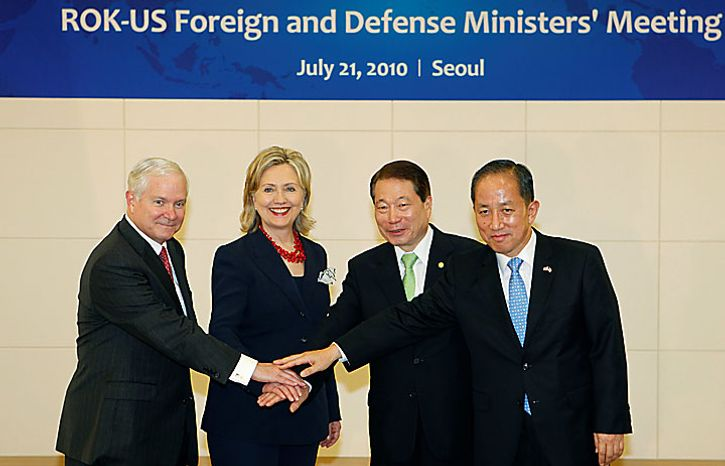 Defense Secretary Robert Gates, left,  Secretary of State Hillary Rodham Clinton, second from left, South Korean Foreign Minister Yu Myung-hwan and South Korean Defense Minister Kim Tae-young pose before their meeting at the Central Government Complex of South Korea in Seoul, Wednesday, July 21, 2010. (AP Photo/Lee Jae-Won, Pool)