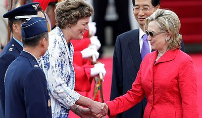 Secretary of State Hillary Rodham Clinton, right, shakes hands with U.S. Ambassador to South Korea Kathleen Stephens as Han Duck-soo, South Korean ambassador to the United States, second from right, looks on upon Mrs. Clinton's arrival at the Seoul Military Airport in Seongnam, South Korea, Wednesday, July 21, 2010. (AP Photo/Ahn Young-joon)
