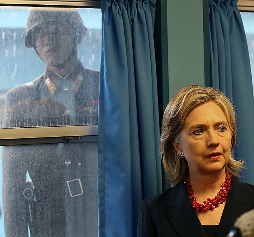 A North Korean soldier looks through a window at Secretary of State Hillary Rodham Clinton while she visits the U.N. truce building in Panmunjom village in the demilitarized zone that separates the two Koreas on Wednesday, July 21, 2010. (AP Photo/Mark Wilson, pool)