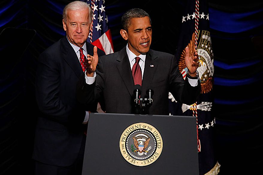 President Obama speaks before he signs the Dodd-Frank Wall Street Reform and Consumer Protection Act at the Ronald Reagan Building and International Trade Center in Washington on Wednesday, July 21, 2010. At left is Vice President Joseph R. Biden Jr. (AP Photo/Charles Dharapak)