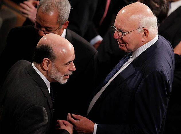 Federal Reserve Chairman Ben S. Bernanke (left) speaks with former Federal Reserve Chairman Paul Volcker before President Obama signs the Dodd-Frank Wall Street Reform and Consumer Protection Act at the Ronald Reagan Building and International Trade Center in Washington on Wednesday, J