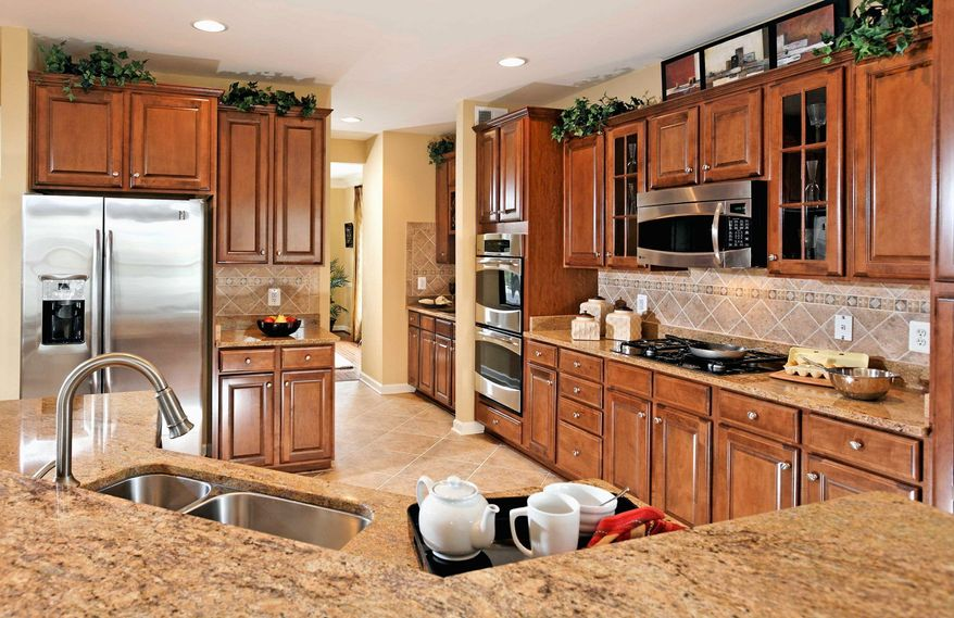 The center-island kitchen in the Dixon model at the Village of Idlewild has 42-inch cabinets and recessed lighting. It has 2,508 square feet and is priced from $259,990 to $279,990.