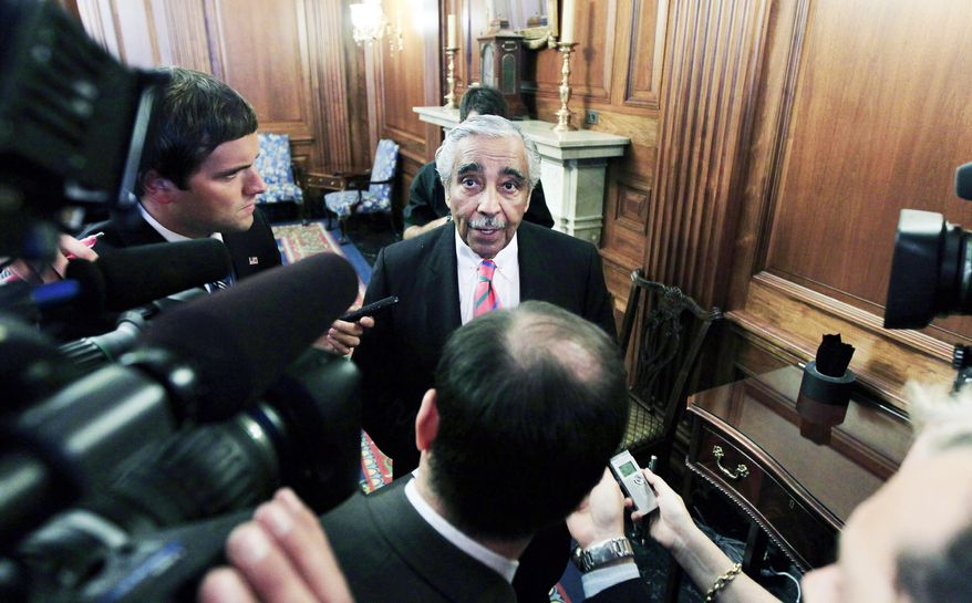 ASSOCIATED PRESS Rep. Charles B. Rangel, New York Democrat, answers questions about ethics charges on Capitol Hill on Thursday. The former chairman of the House Ways and Means Committee has been called on to resign by the leader of a watchdog organization.