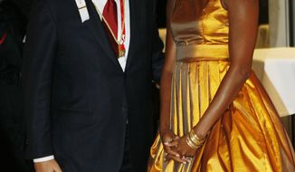 ** FILE ** In this Oct. 1, 2009 file photo, first lady Michelle Obama talks with Prince Albert of Monaco at a reception following the opening ceremonies of the the 121st International Olympic Committee (IOC) Session and XIII Olympic Congress at the Copenhagen Opera House in Copenhagen. (AP Photo/Charles Dharapak)
