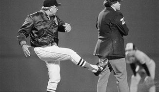 FILE - In this Sept. 16, 1983, file photo, Boston Rex Sox manager Ralph Houk, left, kicks dirt at umpire John Shulock after Shulock called Boston's Wade Boggs out at second base in a baseball game against the Baltimore Orioles at Fenway Park in Boston. The Red Sox say former manager Houk has died. He was 90. Red Sox spokesman Dick Bresciani says Houk died in Winter Haven, Fla., on Wednesday afternoon, July 21, 2010. The team heard from Houk's grandson, who lives in the Boston area. The cause of death was not immediately known. (AP Photo/Ted Gartland, File)