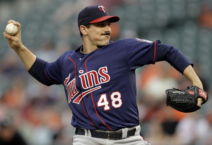 ASSOCIATED PRESS Minnesota Twins starting pitcher Carl Pavano delivers to a Baltimore Orioles batter during the second inning of a baseball game on Thursday, July 22, 2010, in Baltimore.