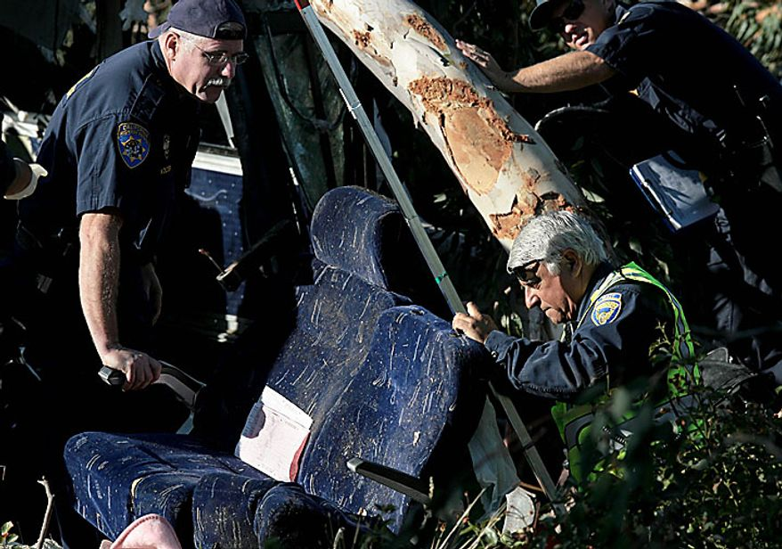 California Highway Patrol investigators look over seats from a fatal Greyhound bus accident in Fresno, Calif. on Thursday, July 22, 2010, in which at least six people were killed and others injured. (AP Photo/The Fresno Bee, John Walker)