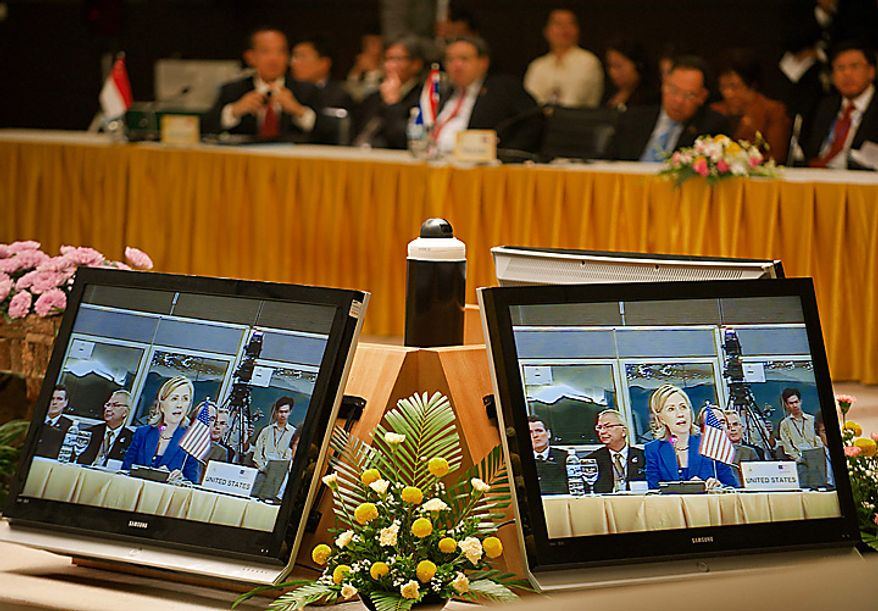 U.S. Secretary of State Hillary Rodham Clinton is seen on television monitors while she delivers remarks as delegates, top, listen during the ASEAN-US Ministerial Meeting, Thursday, July 22, 2010, in Hanoi, Vietnam.   (AP Photo/Paul J. Richards, Pool)