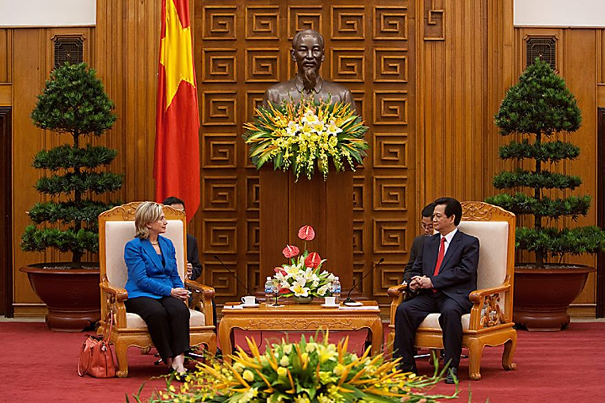 """Hillary Clinton, U.S. secretary of state, left, and Nguyen Tan Dung, Vietnam's prime minister, meet at the Office of the Prime Minister in Hanoi, Vietnam, on Thursday, July 22, 2010. The U.S. is ready to take relations with Vietnam to a """"new level"""" 15 years after establishing diplomatic ties with its former adversary, Secretary of State Clinton said. (Photographer: Nelson Ching/Bloomberg)"""