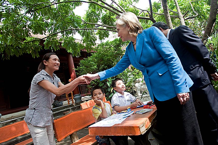 Hillary Clinton, U.S. secretary of state, visits the Ngoc Lam pagoda, which receives funding from the U.S. President's Emergency Plan for AIDS Relief (PEPFAR), in Hanoi, Vietnam, on Thursday, July 22, 2010. The U.S. is ready to take relations with Vietnam to a 'new level' 15 years after establishing diplomatic ties with its former adversary, Clinton said. (Photographer: Nelson Ching/Bloomberg)