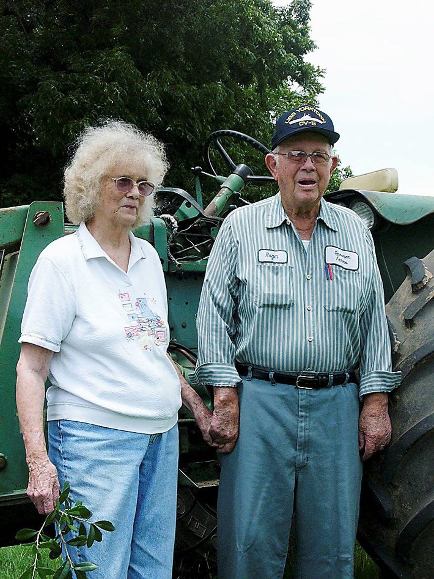 Eloise Spooner, 82, poses with her husband, George, 88, at their farm near Iron City, Ga., on Wednesday, July 21, 2010. Shirley Sherrod, a black USDA official, was fired when she said in a speech that she had failed to give Spooner her full support when he faced the loss of his family farm in the 1980s, long before she went to work for the USDA. (AP Photo/Elliott Minor)
