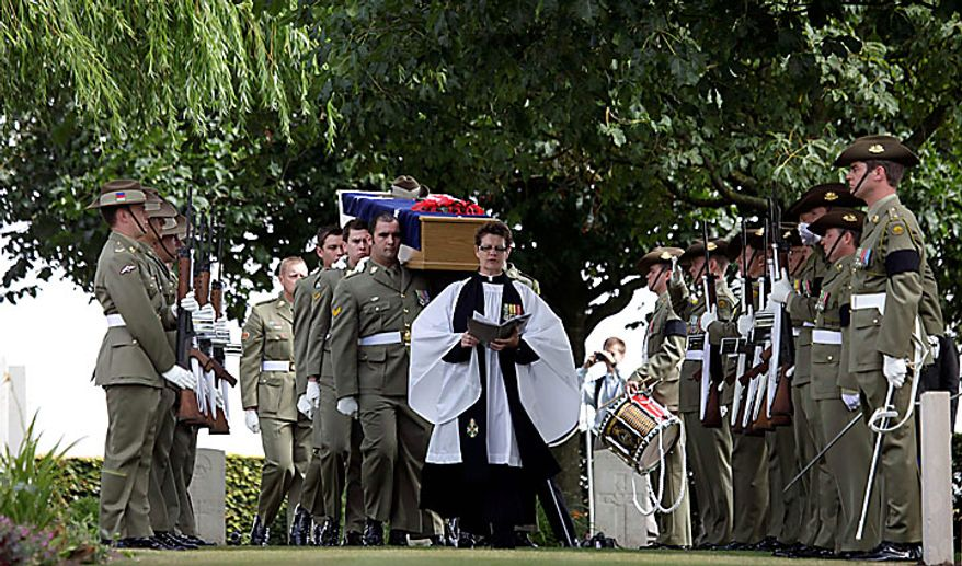 Members of the Australian Federation Guard carry the coffin of Australian WWI soldier, Private Alan James Mather, during a re-burial ceremony at Prowse Point Cemetery in Ploegsteert, Belgium, on Thursday, July 22, 2010. Mr. Mather, originally from Invernell, NSW, Australia was one of 216,000 men from Australia, New Zealand and the UK who fought in the Battle of Messines from June 7-14, 1917. (AP Photo/Virginia Mayo)