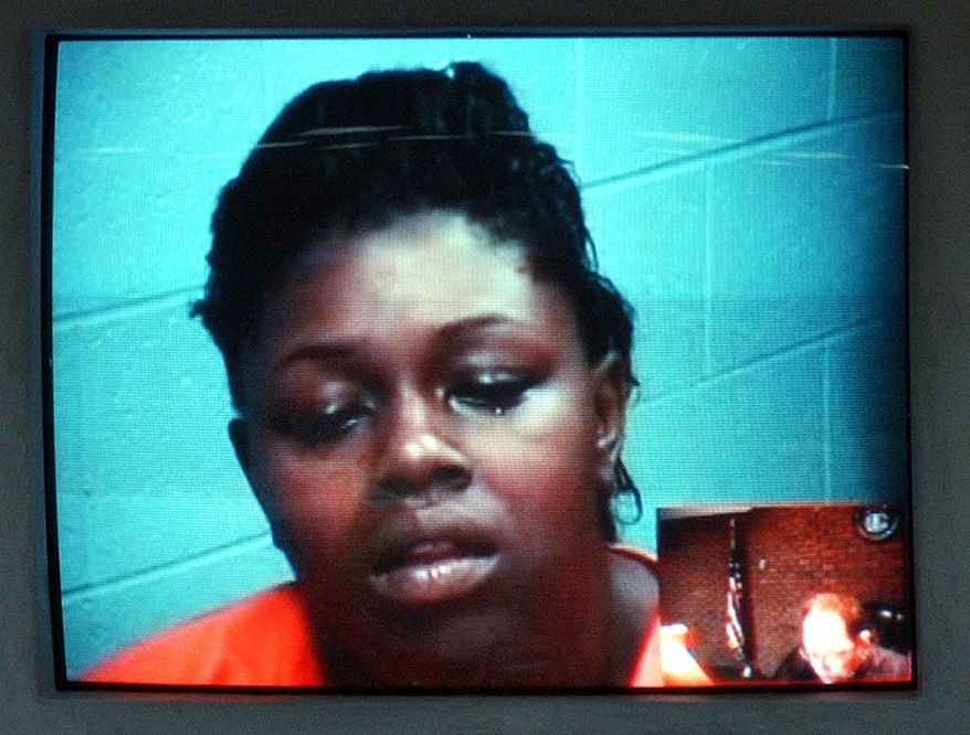 Torrie Emery appears in a video arraignment in Pontiac, Mich. on Friday July 23, 2010. Torrie Emery was charged with second-degree murder, assault and child abuse in a fatal car crash stemming from a dispute on the social networking site Facebook. Police say the 23-year-old woman had her 3-year-old daughter in the car Wednesday afternoon when she rammed a car being driven by Alesha Abernathy of Pontiac. Police said Abernathy's car hit a dump truck while being chased. (AP Photo/The Oakland Press, Vaughn Gurganian)