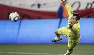Tottenham goalie Carlo Cudicini dives to make a save during the second half of an exhibition soccer match against the New York Red Bulls on Thursday, July 22, 2010, in Harrison, N.J. Tottenham won 2-1. (AP Photo/ Mel Evans)