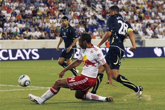 New York Red Bulls' Thierry Henry (14) takes a shot past Tottenham's Kyle Walker  (28) during the first half of an exhibition soccer match Thursday, July 22, 2010, in Harrison, N.J. Tottenham won 2-1. (AP Photo/ Mel Evans)