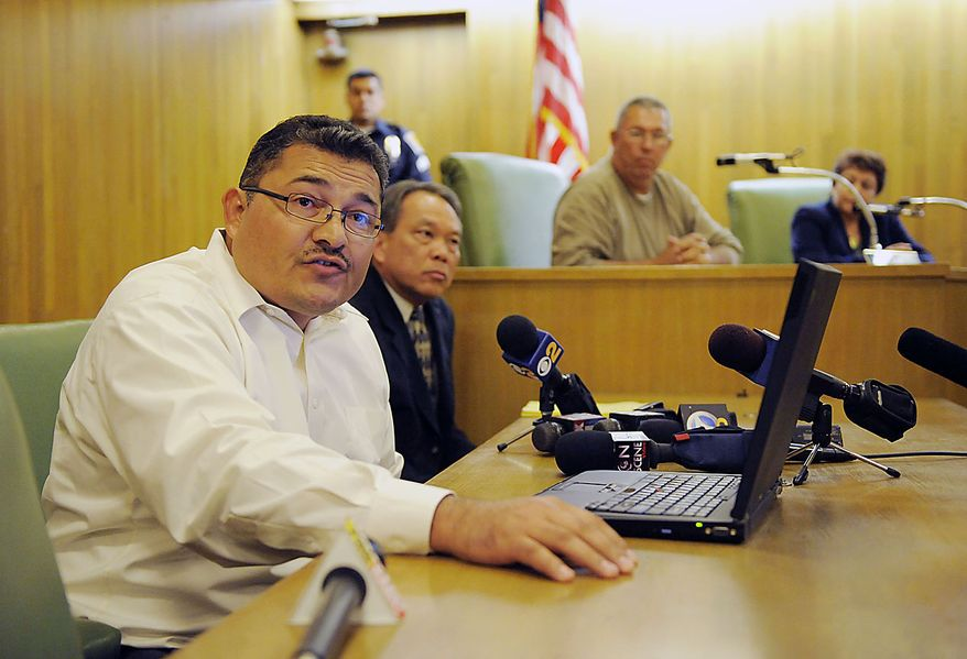 Pedro Carrillo, left, interim city manager of Bell, Calif., announces the resignations of three of Bell's top administrators during a special city council meeting, Thursday, July 22, 2010, in Bell, Calif. Council members emerged from an hours-long closed session at midnight Friday and announced that they'd accepted the resignations of Chief Administrative Officer Robert Rizzo, Assistant City Manager Angela Spaccia and Police Chief Randy Adams. Rizzo was the highest paid at $787,637 a year, nearly twice the pay of President Barack Obama, for overseeing one of the poorest towns in Los Angeles County. Spaccia makes $376,288 a year and Adams earns $457,000, 50 percent more than Los Angeles Police Chief Charlie Beck. (AP Photo/Chris Pizzello)