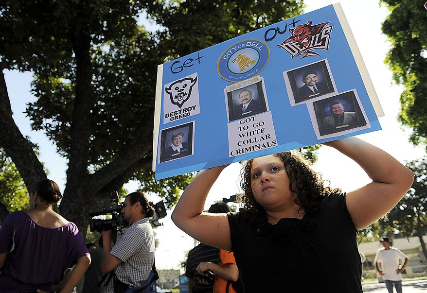 Briana Esqueda, 10, of Bell, Calif., holds a sign outside a special city council meeting to consider firing the police chief and two top administrators in Bell, Calif., Thursday, July 22, 2010. Revelations about Bell city leaders' pay has sparked anger in a blue-collar town that is one of the poorest in Los Angeles County. (AP Photo/Chris Pizzello)