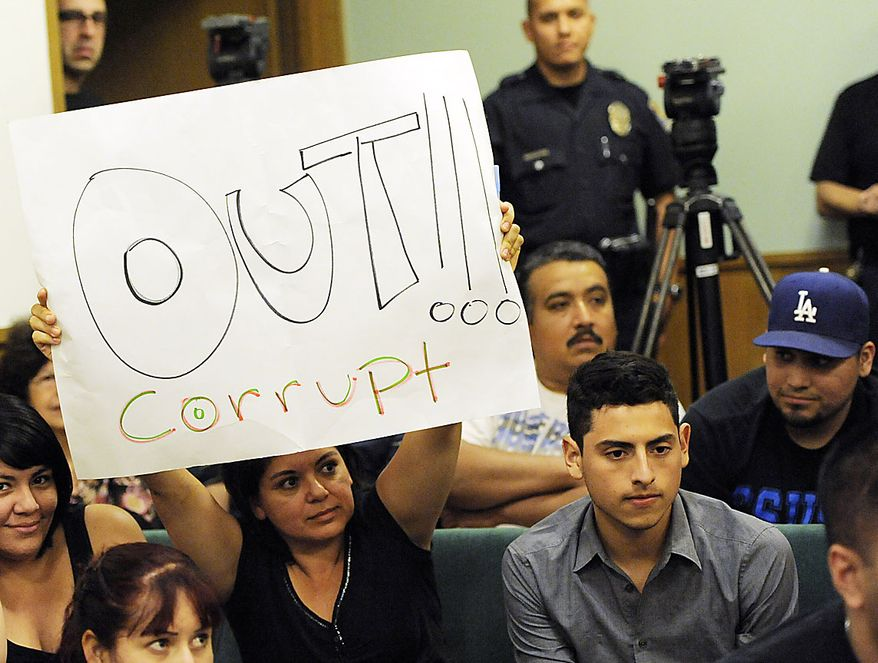A resident of Bell, Calif,. holds up a placard calling for the ouster of city officials during a special city council meeting, Thursday, July 22, 2010, in Bell, Calif. Council members emerged from an hours-long closed session at midnight Friday and announced that they'd accepted the resignations of Chief Administrative Officer Robert Rizzo, Assistant City Manager Angela Spaccia and Police Chief Randy Adams. Rizzo was the highest paid at $787,637 a year, nearly twice the pay of President Barack Obama, for overseeing one of the poorest towns in Los Angeles County. Spaccia makes $376,288 a year and Adams earns $457,000, 50 percent more than Los Angeles Police Chief Charlie Beck.  (AP Photo/Chris Pizzello)